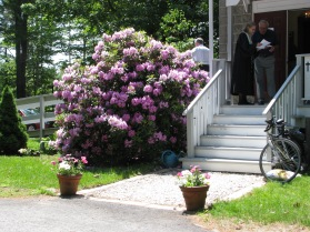 church door with rhododendrons